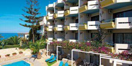 Perhehuone, jossa jaettu uima-allas, Hotelli Rethymno Mare Resort, Kreeta.